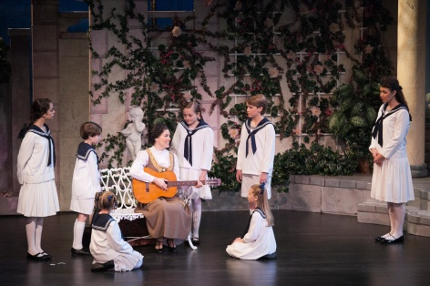 "Sarah Elizabeth Combs as Maria, teaches the von Trapp children to sing in Candlelight Pavilion's ""Sound of Music"""