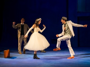 Jules Willcox, as Eurydice, and Graham Sibley as Orpheus, dance at their wedding while Geoff Elliott looks on [photos by Craig Schwartz]
