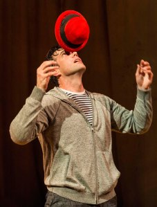 "The little red hat, and Lorenzo Pisoni, in ""Humor Abuse"" [photo: Craig Schwartz]"