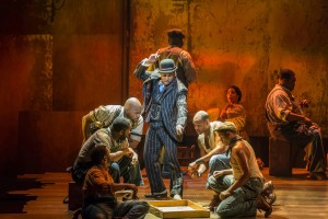 "Kingsley Leggs as Sporting Life challenges the cast of ""Gershwin's Porgy and Bess"""