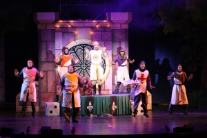 """Raymond Ingram's King Arthur joins in dancing """"The Knights of the Round Table"""" [photo: John LaLonde]"""