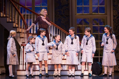 "Kerstin Anderson plays Maria, here surrounded by the Von Trapp children, in the brand new production of Rodgers & Hammerstein''s ""The Sound of Music,"" starting its national tour at the Ahmanson. [Photo: Matthew Murphy]"