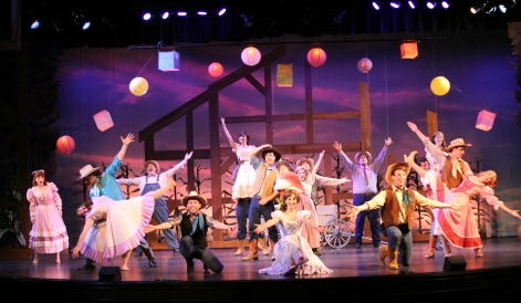"The cast of Candlelight Pavilion's ""Oklahoma"" in a celebrative moment [photo: Demetrius Katsantonis]"