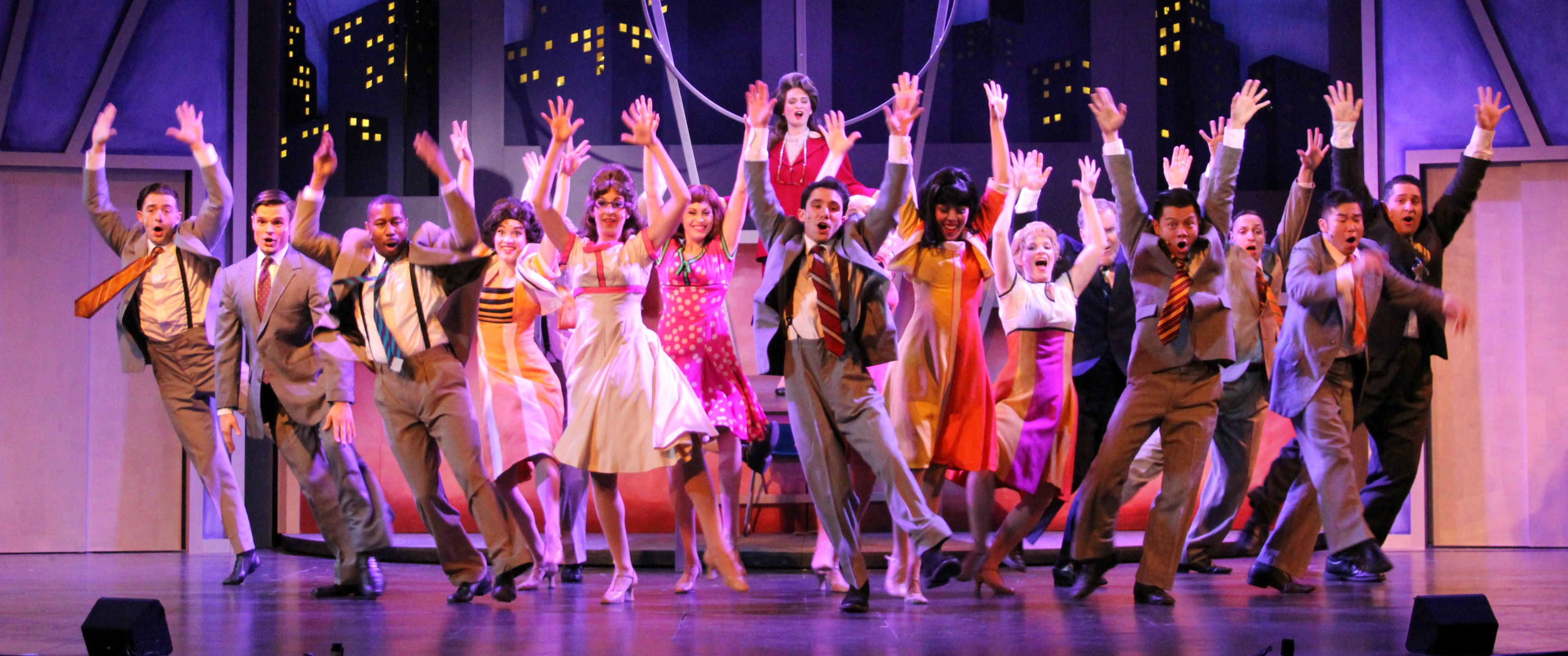"The cast of Candlelight Pavilion's ""How to Succeed in Business without Really Trying"" celebrates ""The Brotherhood of Man"" [photo: John LaLonde]"