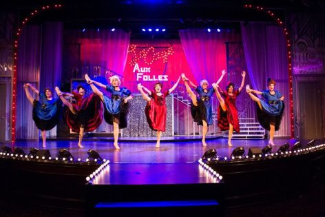 "Members of the chorus of Candlelight Pavilion's production of the Tony-winning, ground-breaking musical ""La Cage Aux Folles"" kick up their heels."