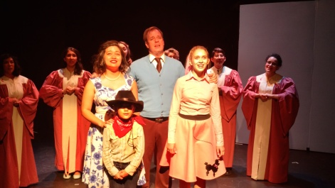 The adult/teen cast of Bye Bye, Birdie sing in celebration of Ed Sullivan: Front - l. to r.- Mirai Booth-Ong, Chloe Lesieur, Tony Prichard, Clara Daly; Rear - Jasmine Einbinder (l.), Meera Sinroja, Stephanie Harvey, Stacy Toyon, Elliott Scott, and Shaina Hammer
