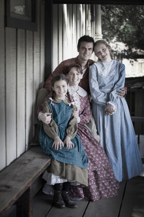 "Sofia Naccarato, Rachel MacLaughlan, Rich Cassone, and Katie-Grace Hansen are Laura, Ma, Pa and Mary Ingalls in ""A Little House Christmas"" at Sierra Madre Playhouse [Photo: Gina Long]"